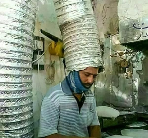 عکس/ ابتکار جالب یک نانوا برای غلبه بر گرما!