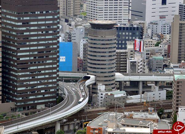 عبور حیرت انگیز بزرگراه از داخل یک ساختمان! +تصاویر